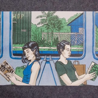 Two women reading on a train