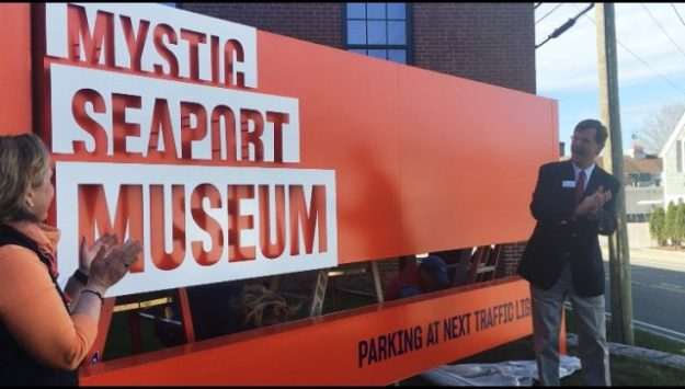 Mystic Seaport Museum President Steve White and Susan Funk, executive vice president and COO, celebrate the unveiling of the Museum's new name , logo and branding on Tuesday, May 1, 2018. Photo: Elissa Bass/Mystic Seaport Museum.