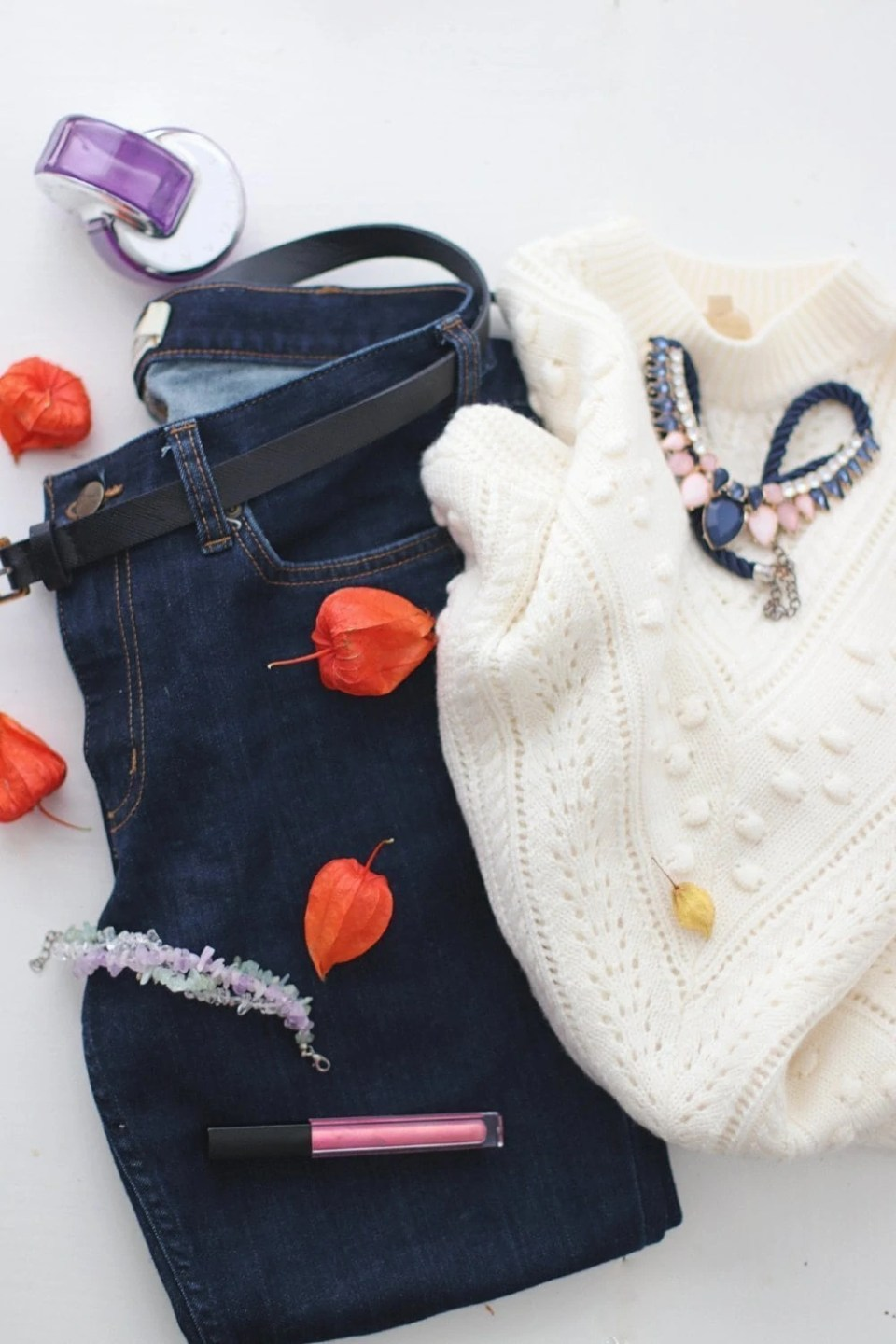 navy jeans cream sweater outfit