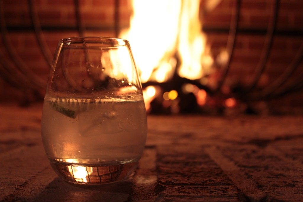 Enjoying some Clemengold Gin by the fireplace at Kalkveld Lounge, Zandvliet Wine Estate.