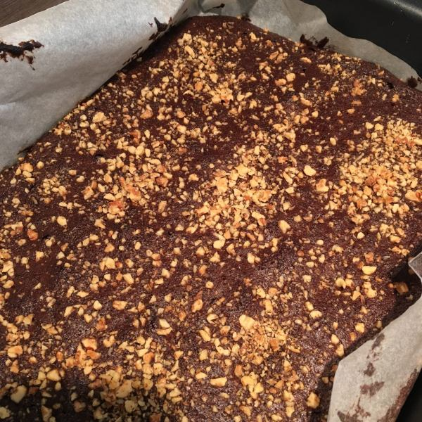 Put in the oven and bake for 25 - 30 minutes (the less the fudgier). When a toothpick is inserted in the center, it shouldn't come out too clean. You want the brownies to stay sticky in the middle, but the outside should already be kind of crunchy. Don't over-bake.
