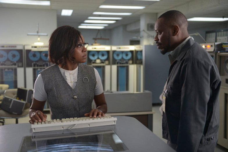 "TIMELESS -- ""Space Race"" Episode 107 -- Pictured: (l-r) Nadine Ellis as Katherine Johnson, Malcolm Barrett as Rufus Carlin -- (Photo by: Sergei Bachlakov/NBC)"