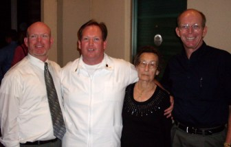 The graduate and his two brothers and grandmother