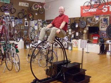 Me riding a big wheel.
