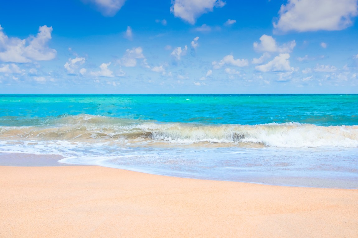 a beautiful sunny beach picture, golden sands and blue sea and sky