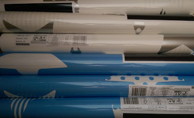 multiple rolls of blue and white starred wallpaper from Graham and Brown
