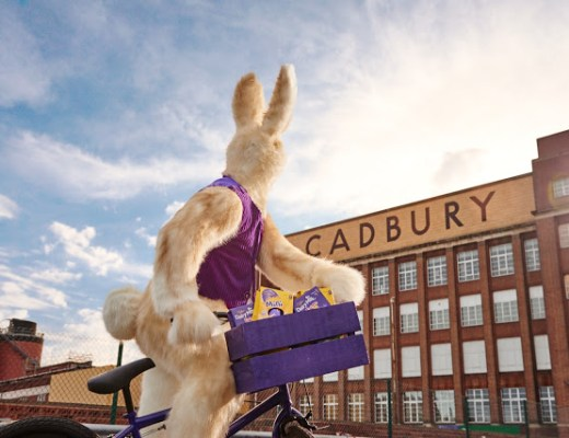 The Easter Bunny on his bicycle outside the Cadbury factory