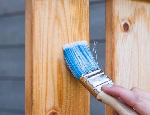 someone varnishing some wooden decking