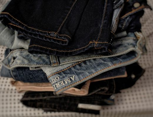A pile of folder pairs of jeans