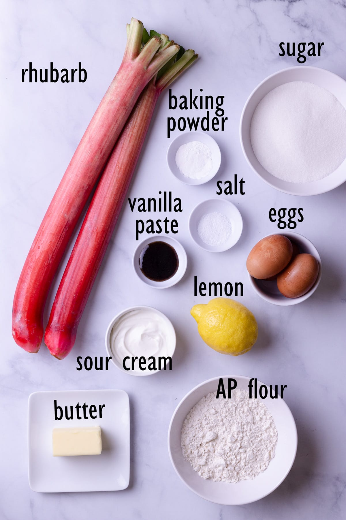 Ingredients including rhubarb, flour, sugar, eggs, baking powder, salt, lemon, butter, sour cream and vanilla.