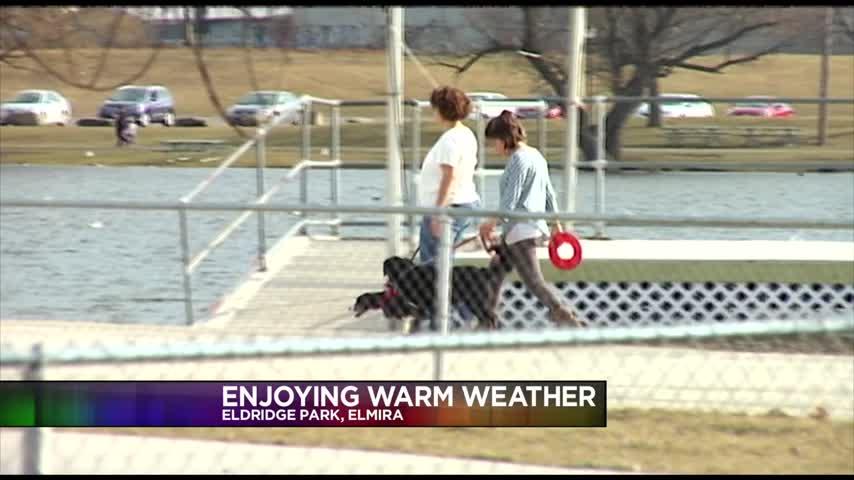 Families Enjoy Warm Weather_88595558