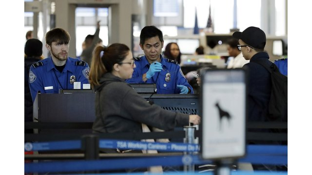 TSA officers work at O'Hare Airport in Chicago_1546788196562.jpeg_66661006_ver1.0_640_360_1546861206257.jpg.jpg