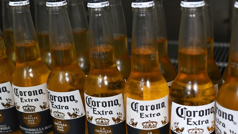 Picture of bottles of Mexican beer Corona, taken in Mexico City on June 4, 2019. – Donald Trump faced fierce opposition Tuesday from his own Republican camp to his threat of tariffs to force Mexico to stem illegal immigration, with top allies warning Congress may not back the US president in his latest trade standoff. Trump has vowed that five-percent tariffs on all imports from its southern neighbor would begin June 10, reaching 25 percent unless Mexico dramatically reduces the flow of undocumented migrants, mainly from Central America, to the US border. (Photo by Rodrigo ARANGUA / AFP) (Photo credit should read RODRIGO ARANGUA/AFP via Getty Images)