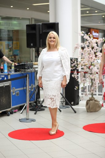 CMPR Model Arlene Kelly wearing Crochet White Top with Floral Print, £22.99 & White Skirt with Overlay, £22.99 @ Quiz Clothing