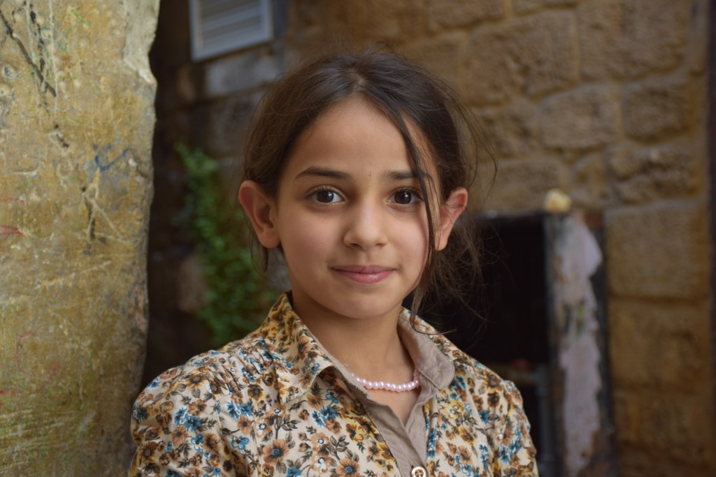 Tripoli, Lebanon, human connections, young girl, smile, happiness