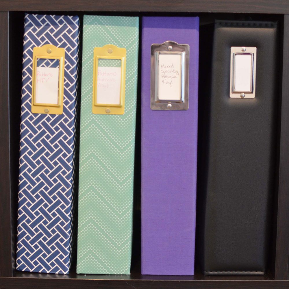 Craft Vinyl organized in scrapbooks by type on a shelf