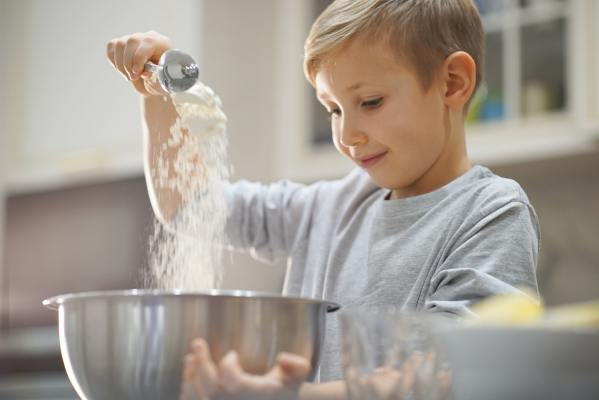 Child cooking at the kitchen.