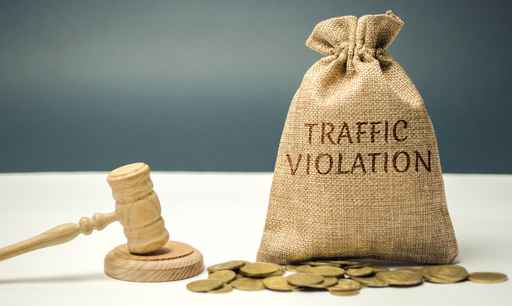 Money bag with the word Traffic violation and the judge's hammer_1556139166335