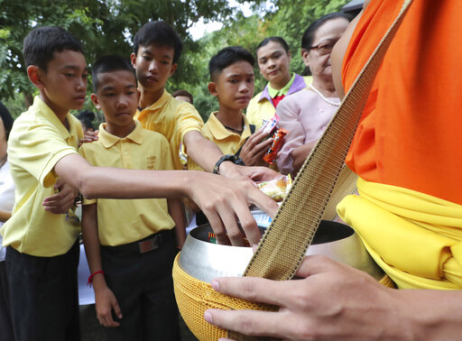 Thai cave boys mark year since ordeal with Buddhist rites | WTWO