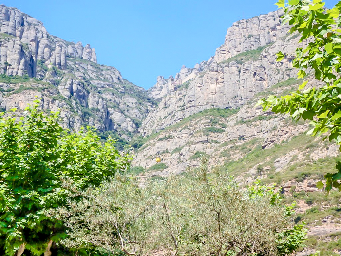 Day trip to Montserrat   4 days in Barcelona, Spain, Catalonia   Things to do in Barcelona   What to do in Barcelona   Catholic monastery   Catalunya   1 day in Montserrat   Serrated Mountains   looking up