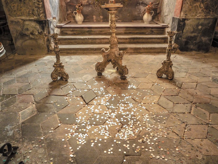 Coins at the Sedlec Ossuary in Kutná Hora, Czech Republic, just one hour from Prague