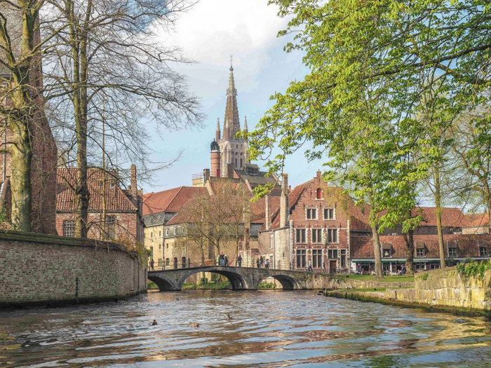Bruges, Belgium | Canal boat ride, bridge, church, medieval architecture