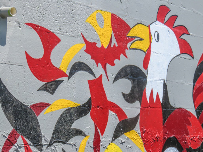 An exploration of Nashville Hot Chicken   Bolton's Spicy Chicken and Fish   Nashville, Tennessee   chicken and waffles, chicken tenders, spicy fried chicken   Southern cuisine   Soul food   outside of the building artwork