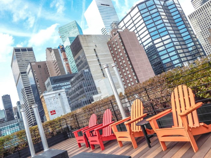 multicolored chairs on a roof in NYC