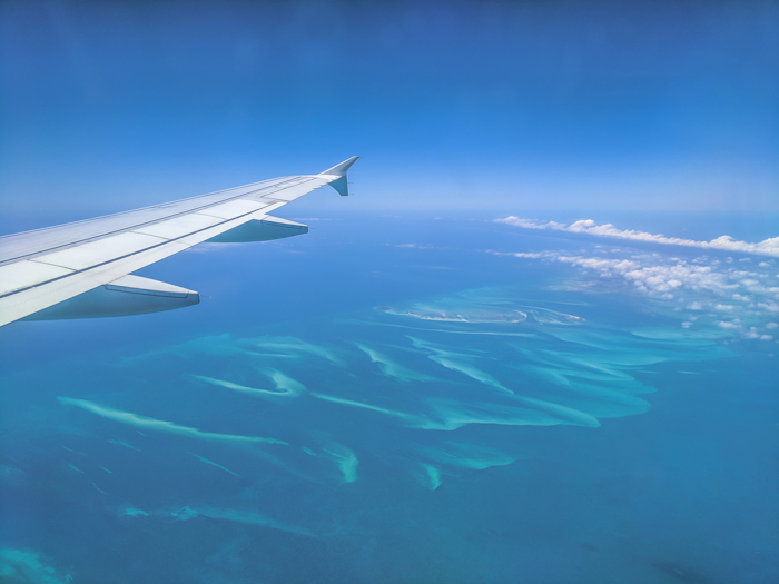 Do This, Not That // 2 Days in The Bahamas   Flying into The Bahamas and seeing the pretty turquoise water of the Caribbean #thebahamas #bahamas #caribbean #wingshot #traveltips #bluewater #turquoise