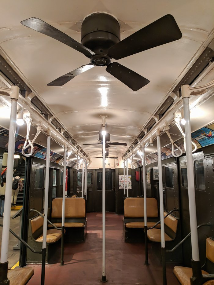 Vintage subway car with ceiling fans at Brooklyn's New York Transit Museum // Underground and Underrated | The best New York City museum you've never heard of | New York City hidden gem | #NewYorkCity #museum #transitmuseum #brooklyn #nycmuseum #traveltip #timebudgettravel