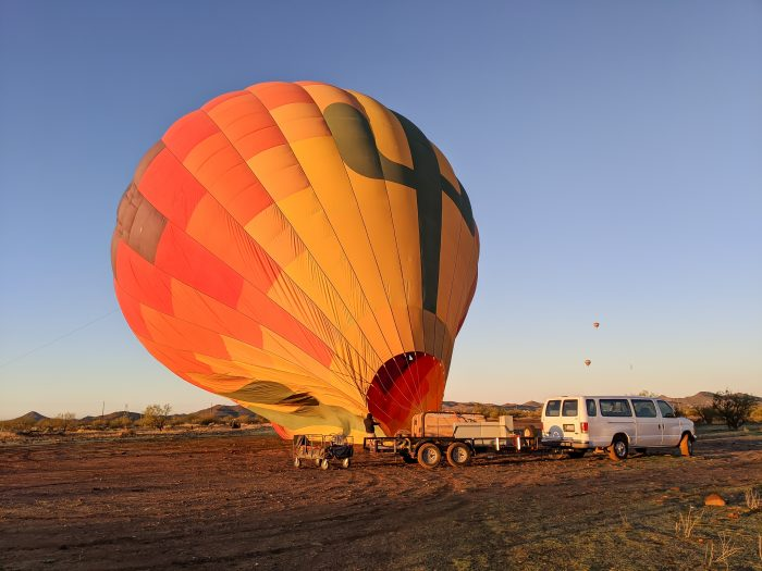 Inflating the hot air balloon | What You Need to Know for Your Sunrise Hot Air Balloon Ride in Arizona | Scottsdale and Phoenix, Arizona hot air balloon rides with Hot Air Expeditions