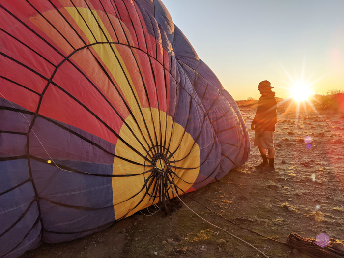 Inflating the balloon at sunrise | What You Need to Know for Your Sunrise Hot Air Balloon Ride in Arizona | Scottsdale and Phoenix, Arizona hot air balloon rides with Hot Air Expeditions