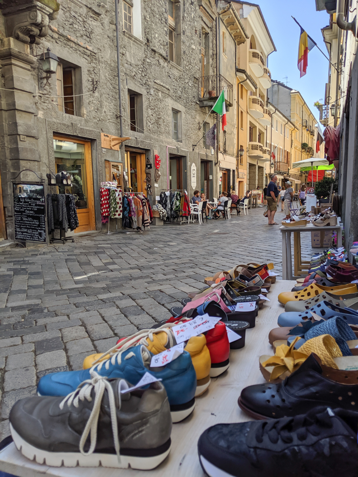 Strolling the streets during Passegiatta, shoe shop | How to Spend 1 Day in Aosta, Italy // The Capital of the Aosta Valley | Things to see in Aosta, Things to do in Aosta, Where to eat in Aosta, the smallest of Italy's 20 regions #aosta #italy #aostavalley #traveltips #timebudgettravel #romanruins #ancient #ruins