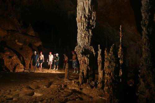 People touring the ATM Cave / What to pack for the ATM Cave in Belize: What to wear, what shoes to wear, what to bring, and what to never, ever bring into the ATM Cave.