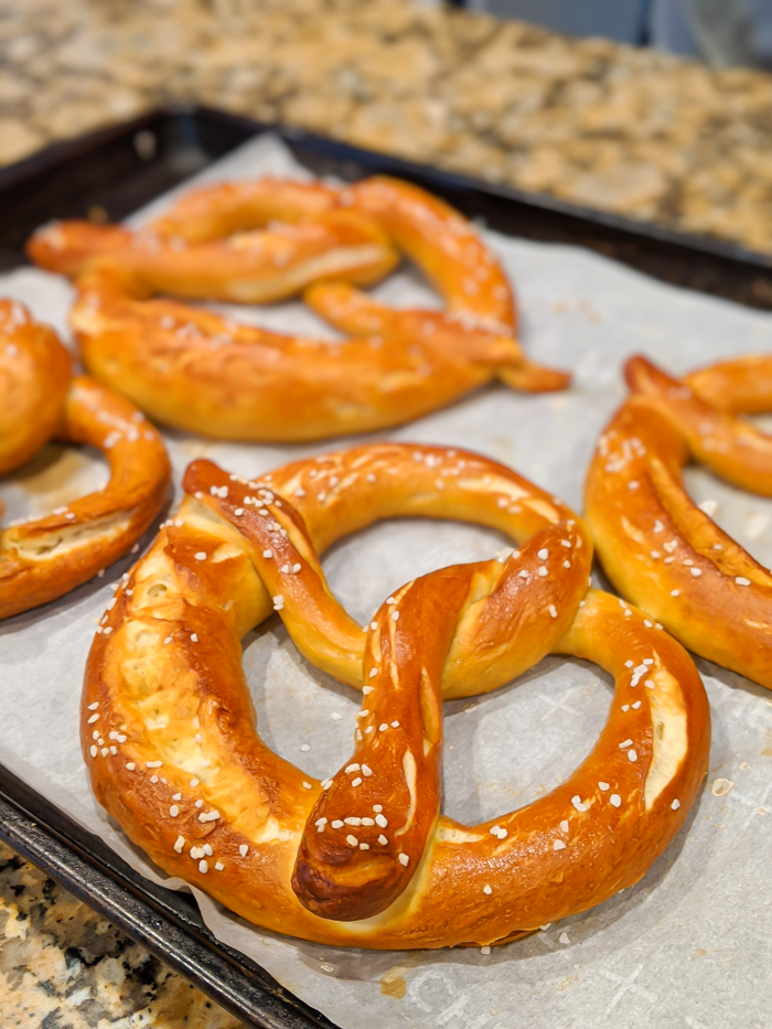 Cooked pretzels on a baking sheet