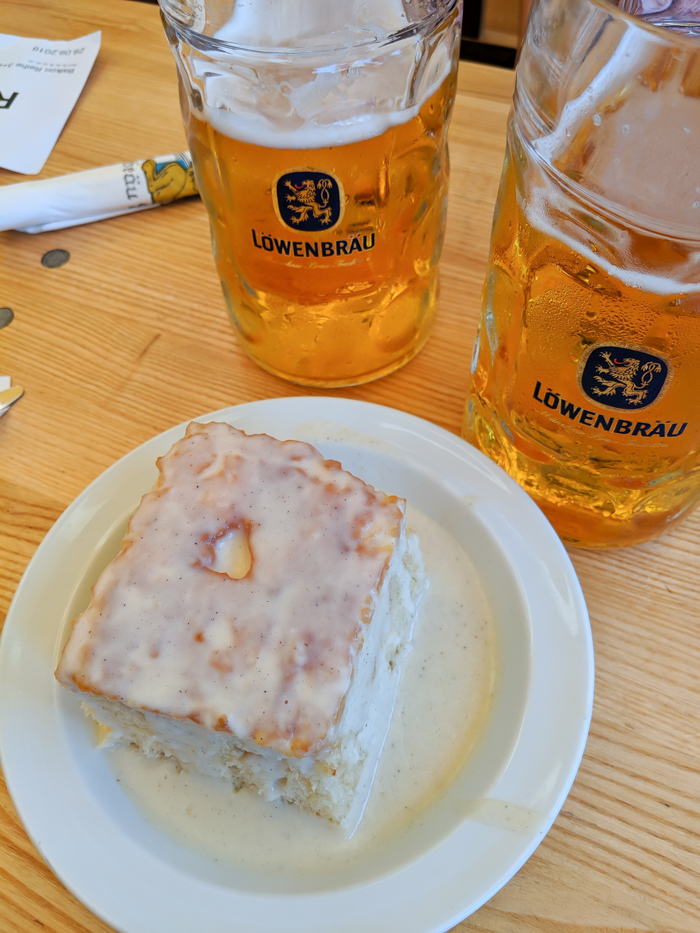 Plate of dampfnudel and Lowenbrau beer at Oktoberfest
