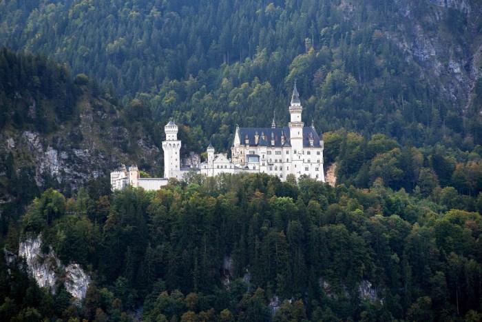 Neuschwanstein Castle from a distance | Where to stay near Neuschwanstein Castle: 12 Best Hotels and Airbnbs in Hohenschwangau, Schwangau, and Füssen