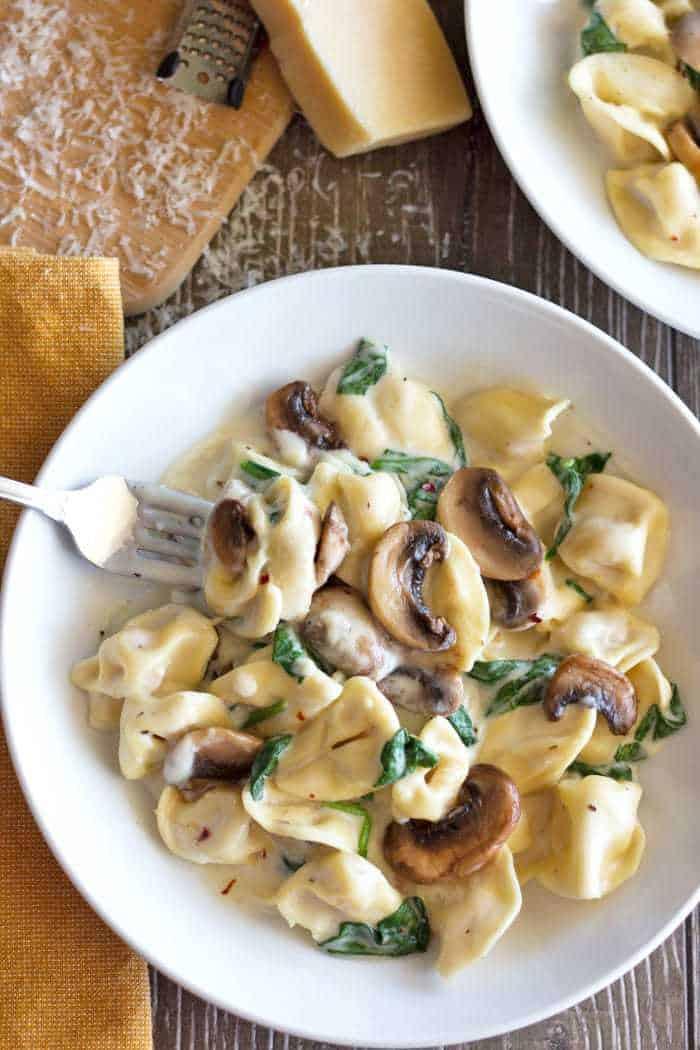 Tortellini Pasta in Mushroom Spinach Cream Sauce. Quick, easy and delicious!