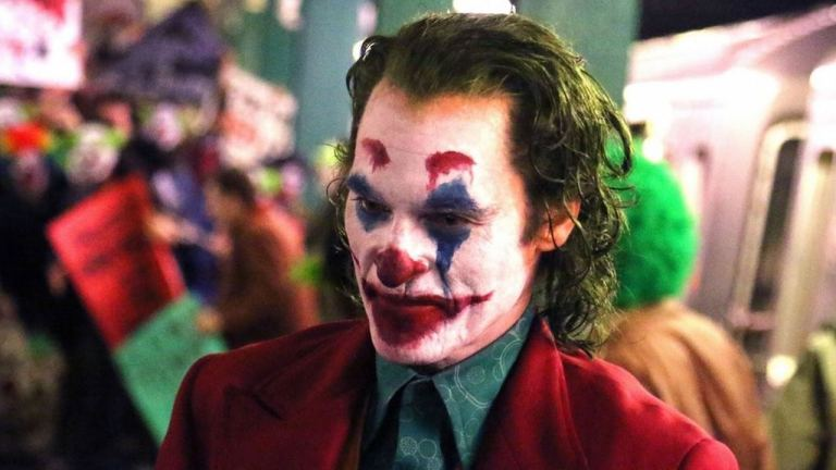 Joaquin Phoenix como Arthur Fleck em Coringa