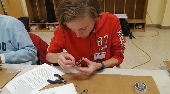 Connor Finchum, KC1GGX building his Pixie Kit
