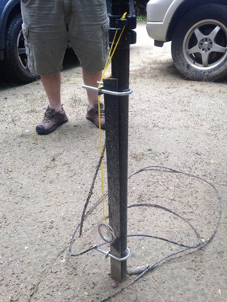 Alternative to guying Buddipole; Mike (NU1H) uses an angle clamp hammered into the ground with some U-bolts attached to the base.
