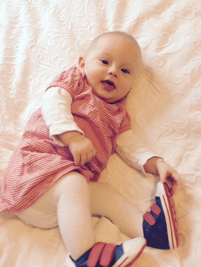 Daisy wearing striped dress from Boden & baby High Tops from M&S