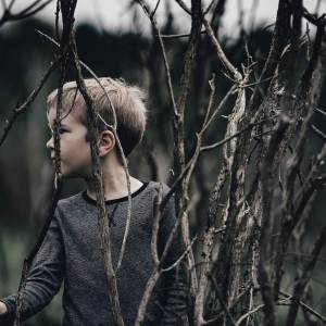 Boy by trees