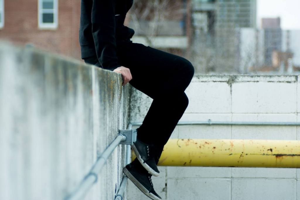 Person sitting on a wall
