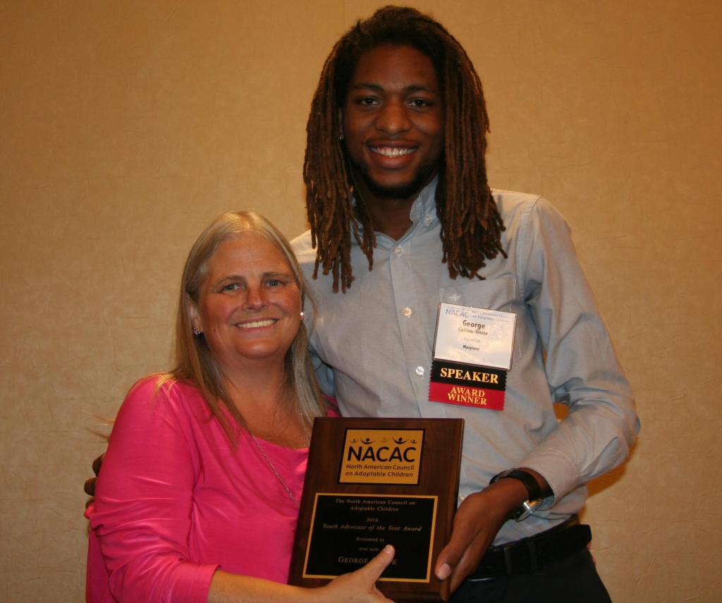 Board chair presenting award to a young man