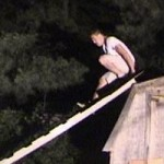 Man attempting to slide down a ladder, subsequently gets hurt