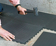 Installation of interlocking rubber tiles; photo courtesy of Best Garage Floor Tiles
