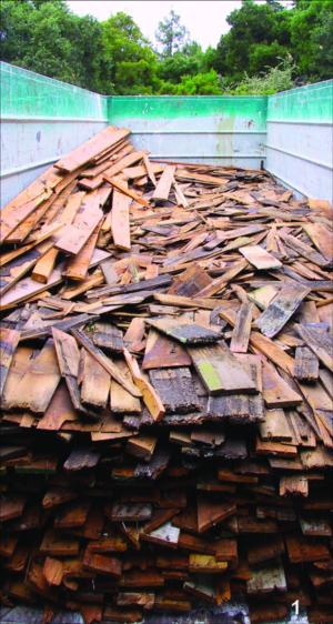 Salvaged lengths of wood to be used in future construction