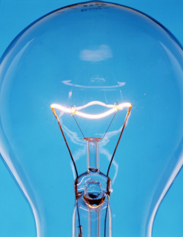 The filament of an incandescent light bulb has high reistance to electric current, which causes it to glow