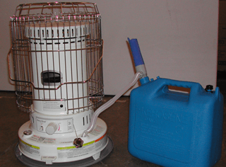 A kerosene heater equipped with a metal grill to prevent contact burns, next to blue kerosene container
